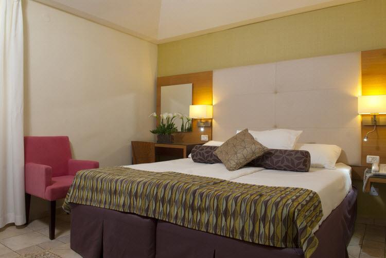 מלון אסטרל וילג' - החדרים